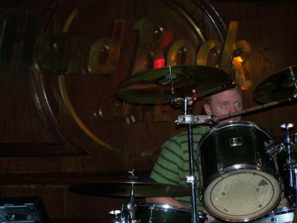 A.J. peeks from his beloved drums